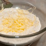 Flour with grated margarine on top