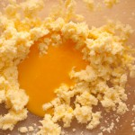 Add the beaten egg yolks