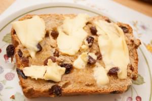 Buttered slice of Bara Brith Fruit Loaf