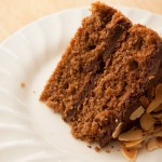 Slice of simple chocolate and almond sponge cake