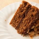 Slice of simple chocolate and almond sponge cake