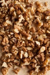 Chopped walnuts on a wooden chopping board