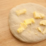 Adding butter to the dough
