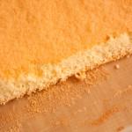 Sloping cut at the far edge of swiss roll sponge