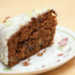 A slice of Iced Date & Walnut Cake on a plate