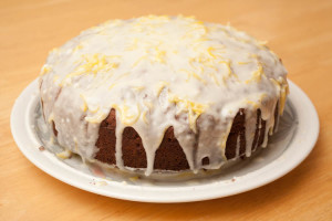 Iced Date and Walnut Cake with the icing added. Note that I used the zest of a whole lemon, so your cake should not have quite so much zest on top.